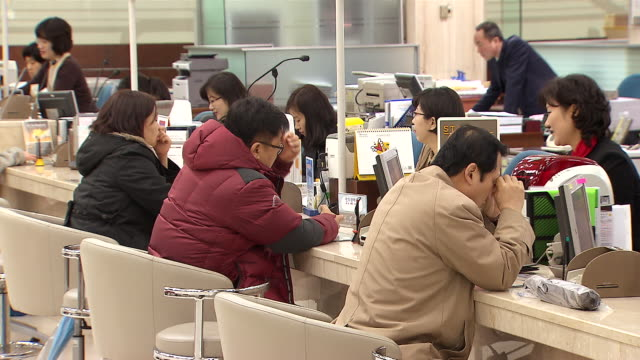 ms shot of bank account between bank teller and customer / seoul, seoul, south korea - south korea stock videos and b-roll footage