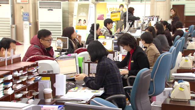 MS Shot of Bank account between Bank Teller and customer / Seoul, Seoul, South Korea