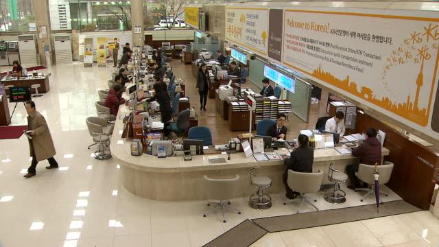 MS PAN Shot of Bank account between Bank Teller and customer / Seoul, Seoul, South Korea