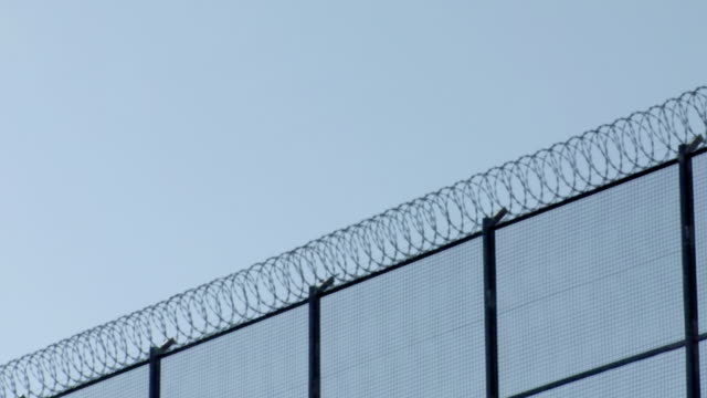 ms shot of barbwired fences / barcelona, spain - prison fence stock videos & royalty-free footage