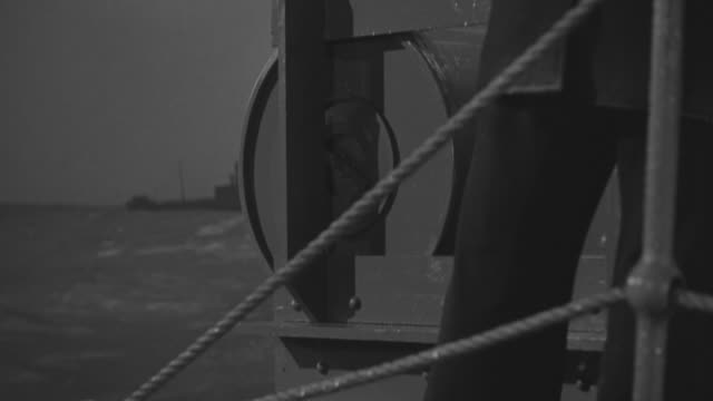cu shot of barrel falling down from ship - militärschiff stock-videos und b-roll-filmmaterial