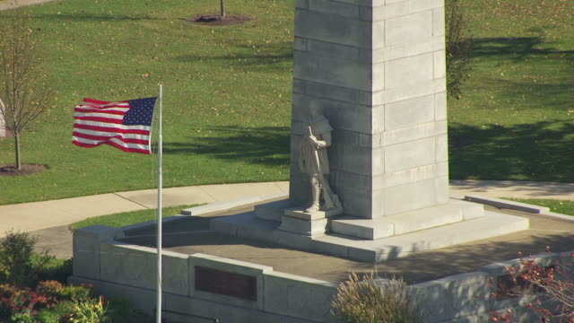 ms ts zo aerial shot of base of fort recovery monument with statue and victory monument obelisk and town / dayton, ohio, united states - dayton ohio stock videos & royalty-free footage