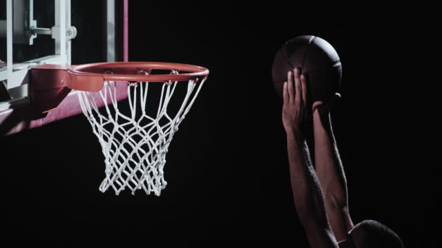 SLO MO shot of basketball player dunking the ball