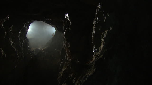 shot of bat flying away in cave at namhan river (tourist attraction) - höhle stock-videos und b-roll-filmmaterial