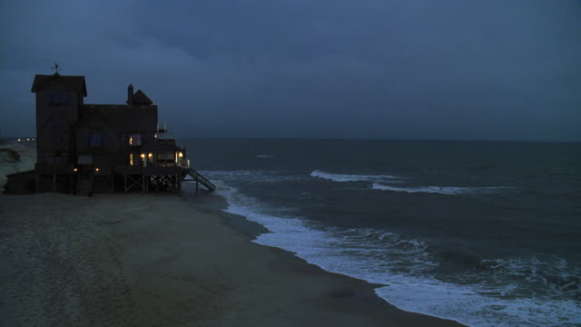 ms shot of beach house at dusk - sequential series stock videos & royalty-free footage