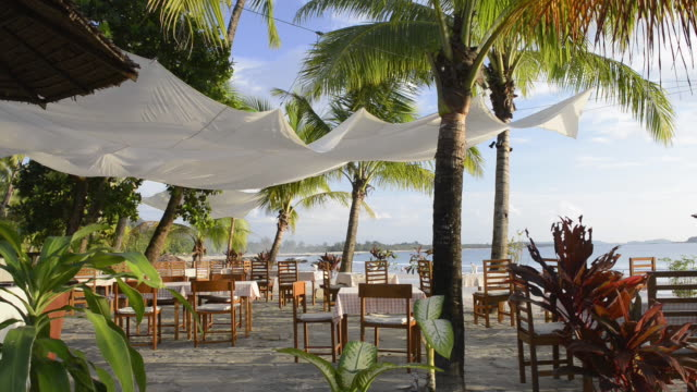 ms shot of beach restaurant at palm beach / ngapali, rakhine state, myanmar - seat stock videos & royalty-free footage