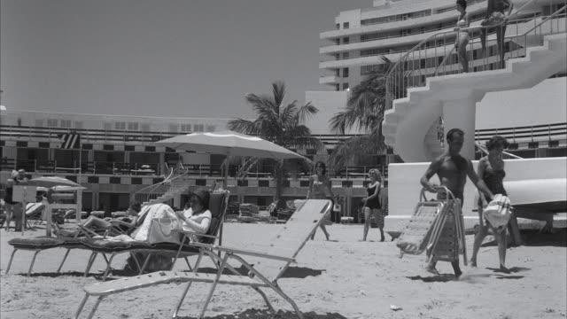 ms shot of beach section of hotel fontainebleau - 1960年点の映像素材/bロール