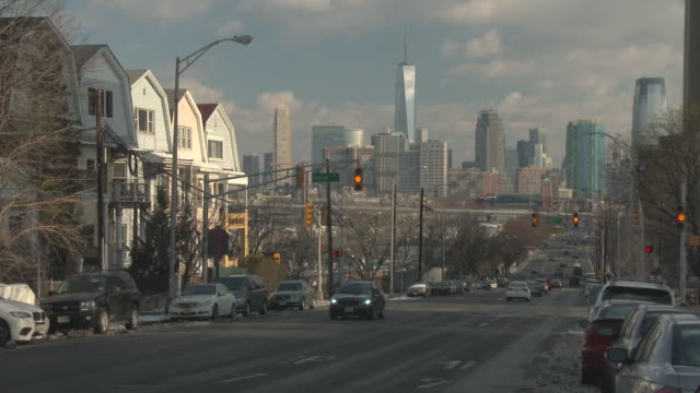 shot of beacon place in jersey city with the downtown manhattan skyline visible. one world trade center can be clearly seen in the background. - new jersey stock videos & royalty-free footage