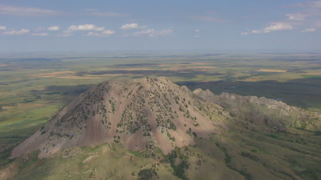 ms aerial shot of bear butte with clouds casting shadows in meade county / south dakota, united states - butte rocky outcrop stock videos & royalty-free footage