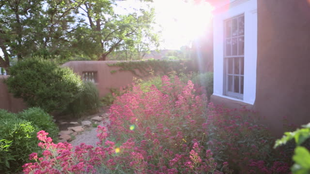 MS PAN Shot of beautiful landscaped garden outside of home / Lamy, New Mexico, United States