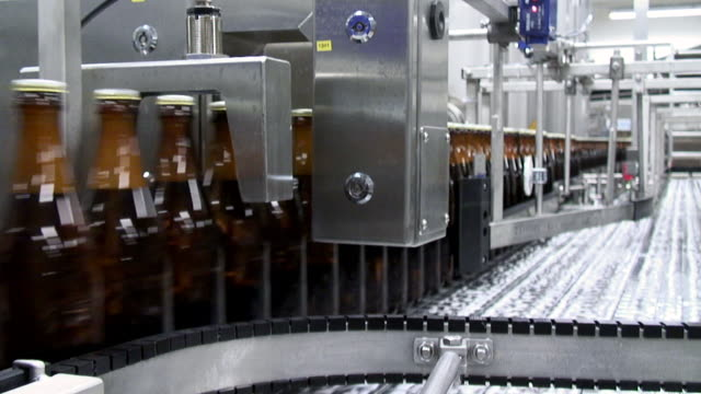 ms shot of beer production at brewery, bitburger pils / bitburg, rhinland palatinate, germany - beer cap stock videos & royalty-free footage