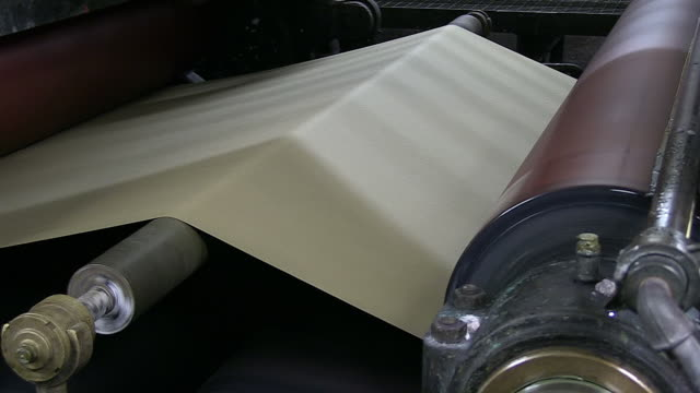 cu shot of being built paper by machine in paper mill / gmund, bavaria, germany - paper mill stock videos & royalty-free footage