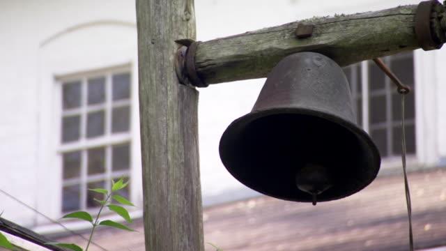 cu shot of bell at back of mendenhall plantation main house / jamestown, north carolina, united states - jamestown stock-videos und b-roll-filmmaterial
