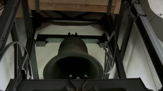 ms shot of bell ringing in church tower / dresden, saxony, germany - bell stock videos and b-roll footage
