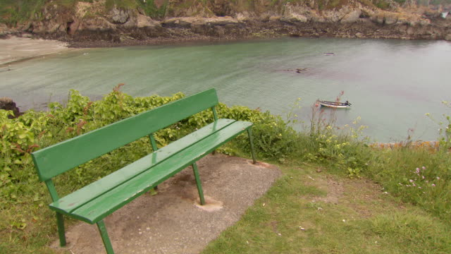 ms shot of bench positioned on edge of the cliff / st. peter port, guernsey, united kingdom - guernsey stock videos and b-roll footage