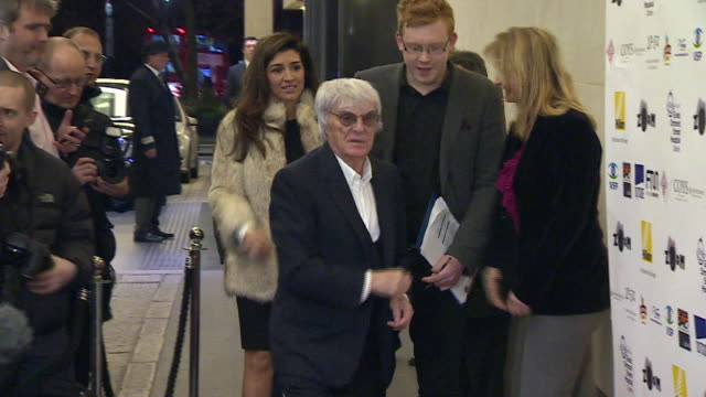 shot of bernie ecclestone arriving at a charity event in london - bernie ecclestone stock videos & royalty-free footage