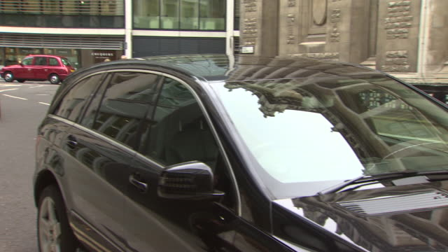 shot of bernie ecclestone arriving at the royal courts of justice. - bernie ecclestone stock videos & royalty-free footage