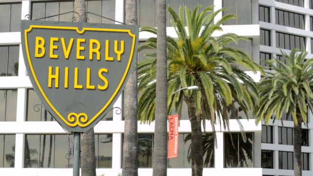 ms shot of beverly hills shield sign / beverly hills, california, united states - beverly hills bildbanksvideor och videomaterial från bakom kulisserna