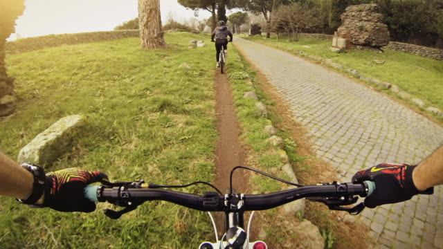 MS POV Shot of bicycle rider driving along Via Appia Antica along mountain bike track / Rome, Italy