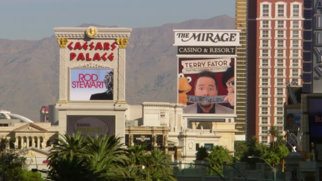 ms shot of big advertise screens in city / las vegars, united states - figura maschile video stock e b–roll