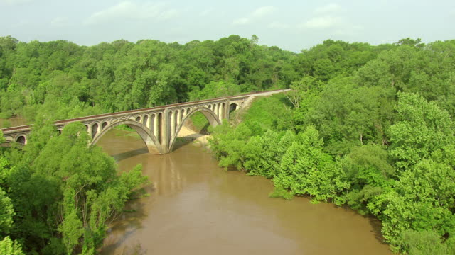 MS AERIAL PAN Shot of Big Black River to reveal bridge from river near town of Eupora in Webster County / Mississippi, United States