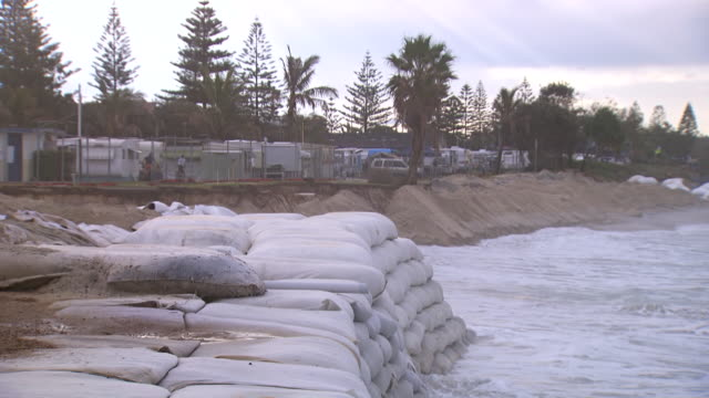 ms shot of big waves splashing on sandbag wall / kingscliff, new south wales, australia - sandbag stock videos and b-roll footage