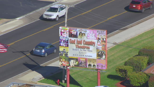 CU AERIAL TS DS Shot of billboard advertising God and Country Theaters / Branson, Missouri, United States