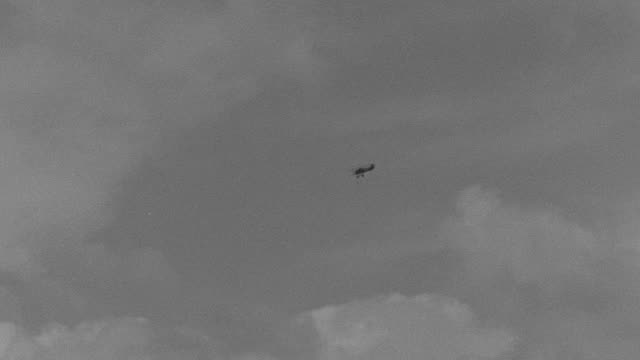 WS TS PAN Shot of biplane in sky flying through clouds