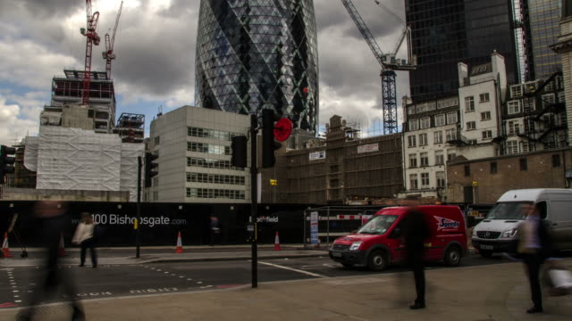 ms t/l shot of bishopsgate city of london with traffic pedestrians and building site and cranes in back side blue sky with clouds / london, greater london, united kingdom - greater london stock videos & royalty-free footage