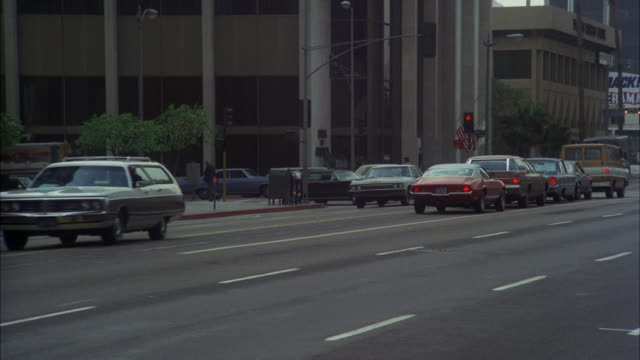 ms ts shot of black cadillac limousine in heavy traffic / los angeles, california, united states - limousine stock-videos und b-roll-filmmaterial