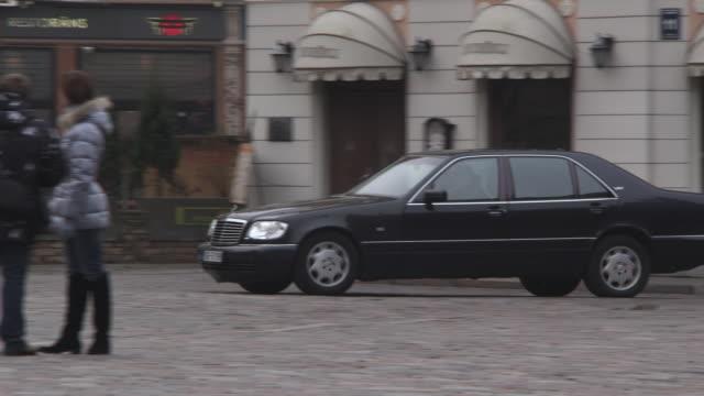 MS TS POV Shot of Black Car driving on street / Riga, Latvia