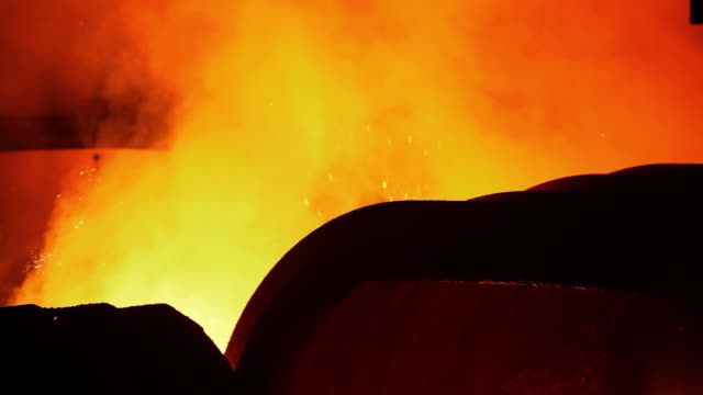 shot of blast furnace with sparks - blast furnace stock videos & royalty-free footage
