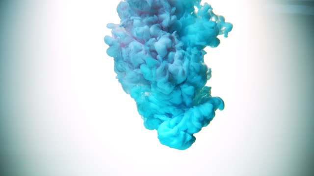 CU SLO MO Shot of Blue and purple paint poured into water / United Kingdom