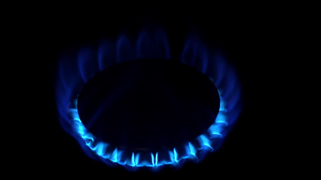 CU Shot of Blue Flame from Gas Cooker against Black background / Calvados, Normandy, France