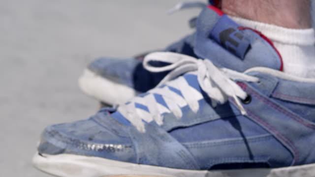 CU SLO MO Shot of  board and shoes / Venice, California, United States