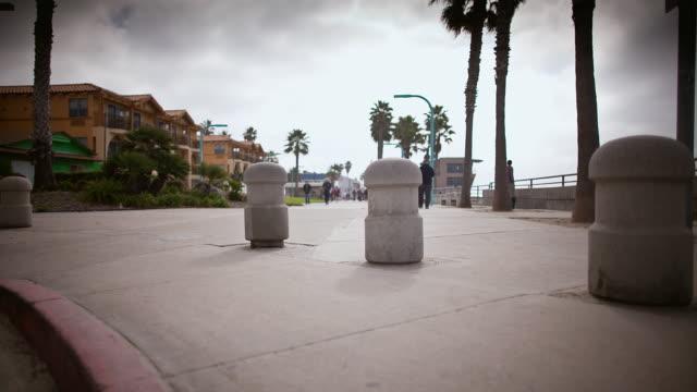 MS POV T/L Shot of boardwalk of city / San Diego, California, United States
