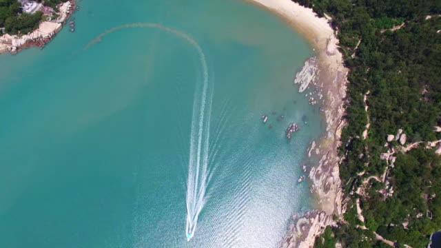 WS AERIAL shot of boat cruising in estuary/Fujian,China