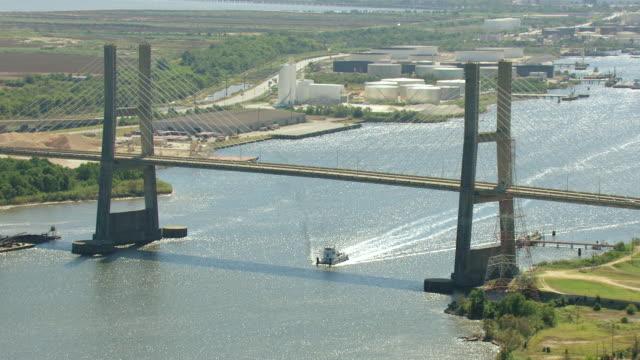 MS AERIAL Shot of boat going under Cochrane Bridge / Mobile, Alabama, United States