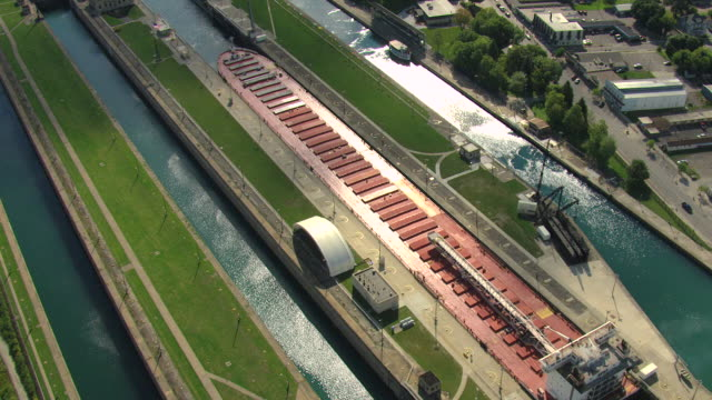 ms aerial shot of boat in soo locks / sault ste marie, michigan, united states - lago superiore video stock e b–roll