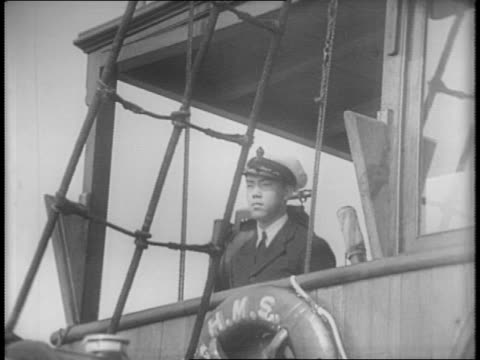 shot of boat on water / british flag flies from boat / major giles and paramount cameraman arthur menken standing together, looking out to see system... - hong kong flag stock videos & royalty-free footage