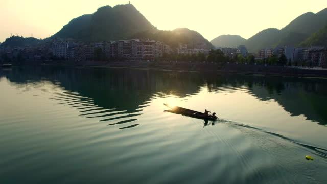 WS AERIAL shot of boat on Wuyang River at sunset,Guizhou,China.