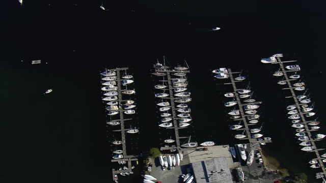 ws aerial zi shot of boat passing along with harbor at mystic / connecticut, united states - new london county connecticut stock videos & royalty-free footage