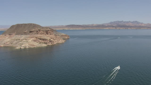 ms aerial ts shot of boat with water skier on lake mead / nevada, united states - lake mead video stock e b–roll