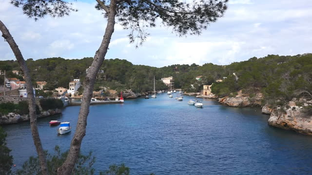 WS Shot of boats at small bay with mountain / Cala Figuera Mallorca, Balearic Islands, Spain