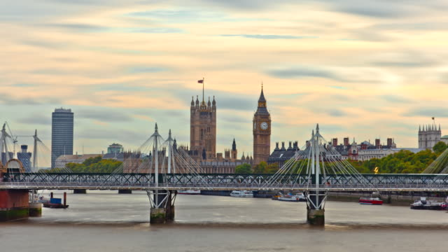 ms t/l shot of boats going under to hungerford bridge in front of big ben / london, united kingdom - hungerford bridge stock videos & royalty-free footage