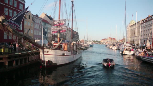 ms slo mo shot of boats in marina next to buildings / copenhagen, denmark - western script stock videos & royalty-free footage