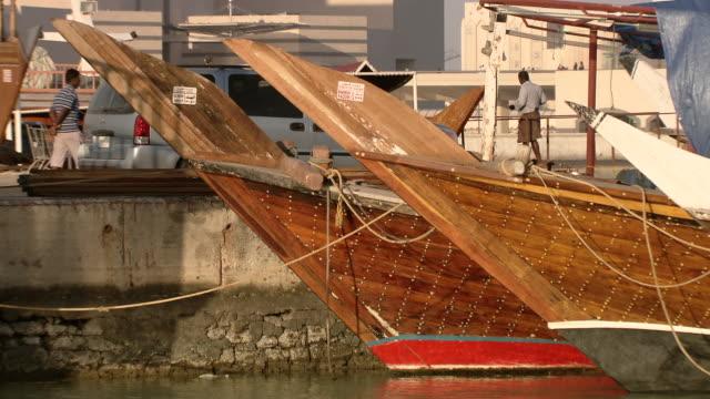 ms pan shot of boats on boat dock / doha, qatar  - doha stock videos & royalty-free footage