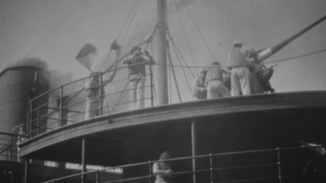 ms shot of bomb falling down on ship during war - warner bros stock videos and b-roll footage