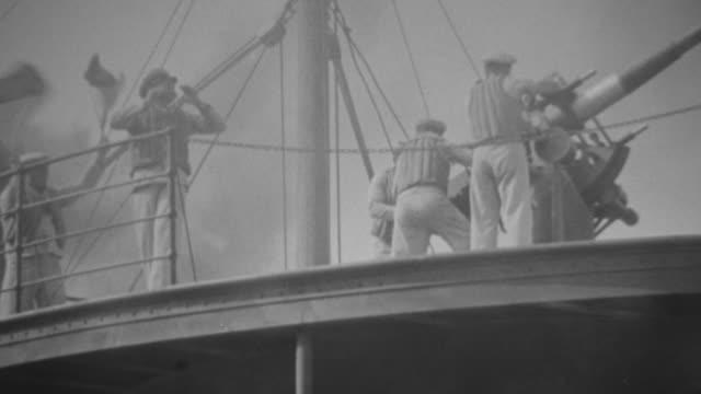 cu shot of bomb falling down on ship during war - marinaio video stock e b–roll