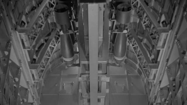 ms shot of bomb racks as bombs are being prepared to drop - bomber plane stock videos and b-roll footage